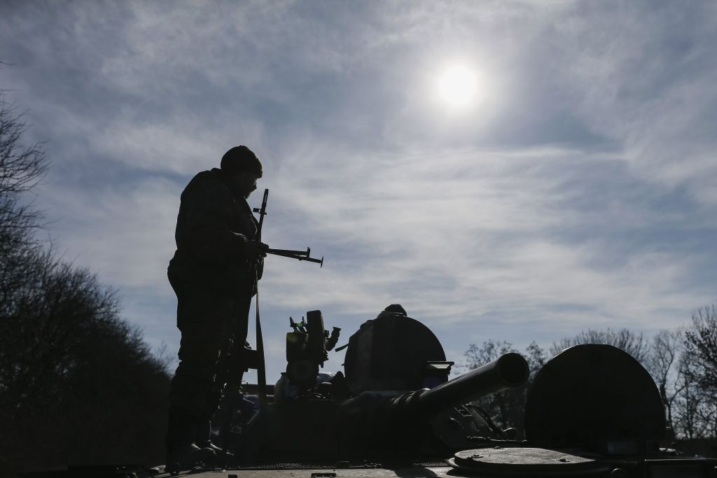 A member of the Ukrainian armed forces stands on an armoured personnel carrier near Artemivsk