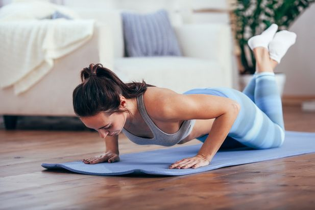 77109744 - women exercise indoor at home she is acted push-ups
