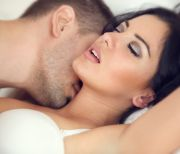 amorous couple making love in bed